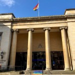 The steps leading up to the main entrance of Gloucestershire County Council on Westgate Street have been painted with chalk paint in the colours of the Pride flag