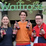 University students raise a glass as their beer hits supermarket shelves